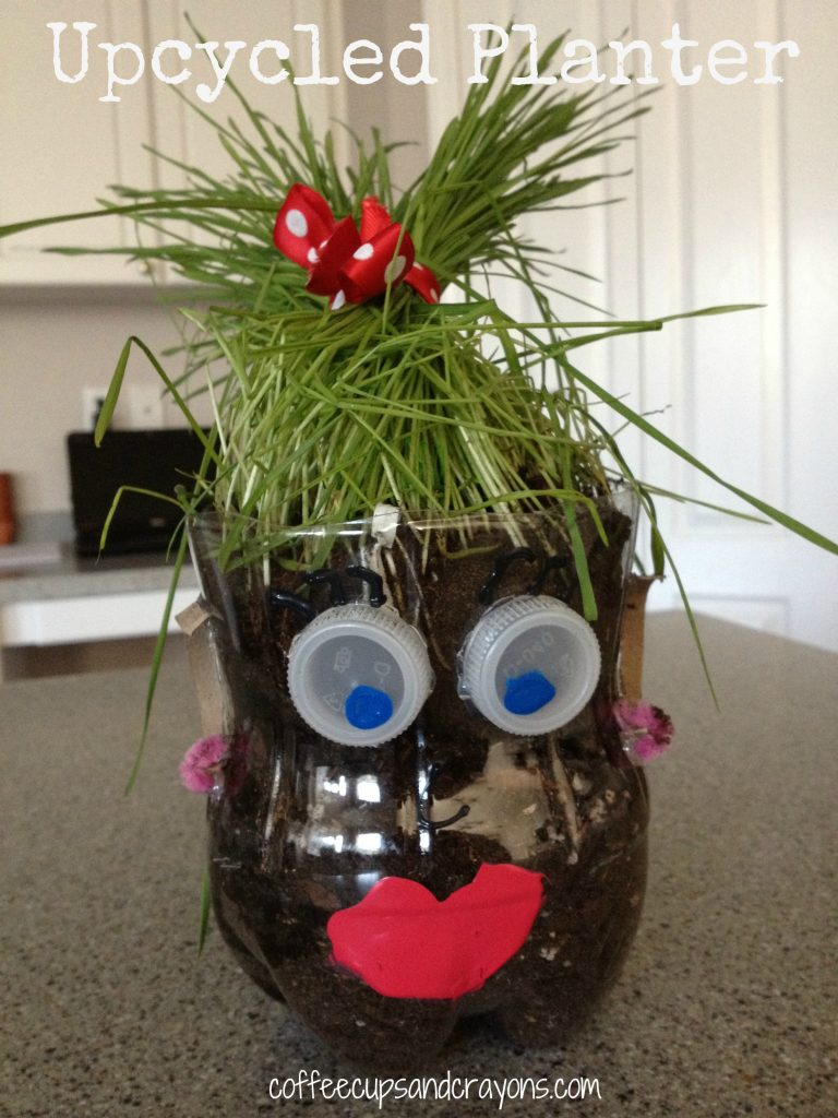 Upcycled Soda Bottle Planter! Kids will love making a person out of a soda bottle and planting hair inside!