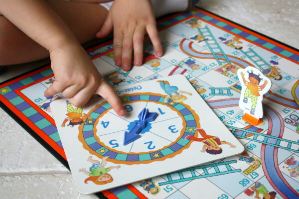 Use Chutes and Ladders game to teach kindergartners the concept of counting on starting at numbers other than one.