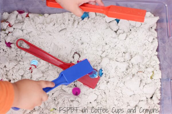 Explore magnets and science with a magnetic sensory bin!
