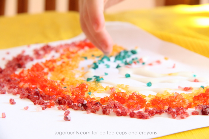Sensory rainbow art with dyed bath salts. These are gorgeous!