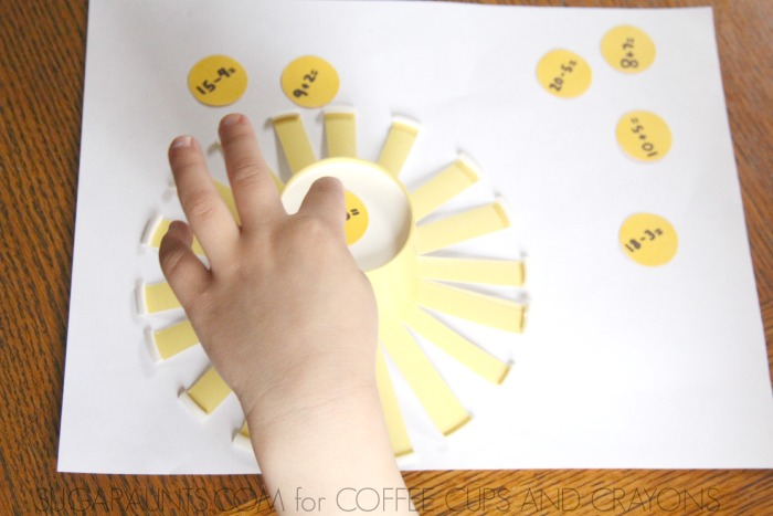 Practice math facts with kids using sunshines made from yellow paper cups.