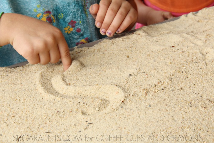 Practice letters and numbers with this sand storytelling table.