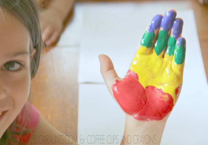 Make a colorful parrot handprint for a cute childhood keepsake.