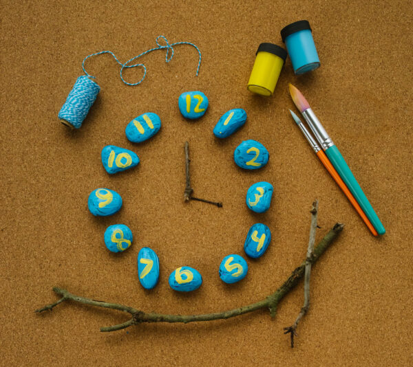 A fun and hands on way to teach kids how to tell time--with a rock clock!