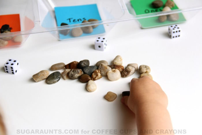 Kids will love to use rocks and dice in this rock and roll place value math activity!