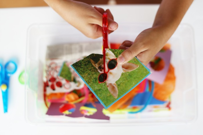 Cutting bin art activity for toddlers! Great scissor practice!