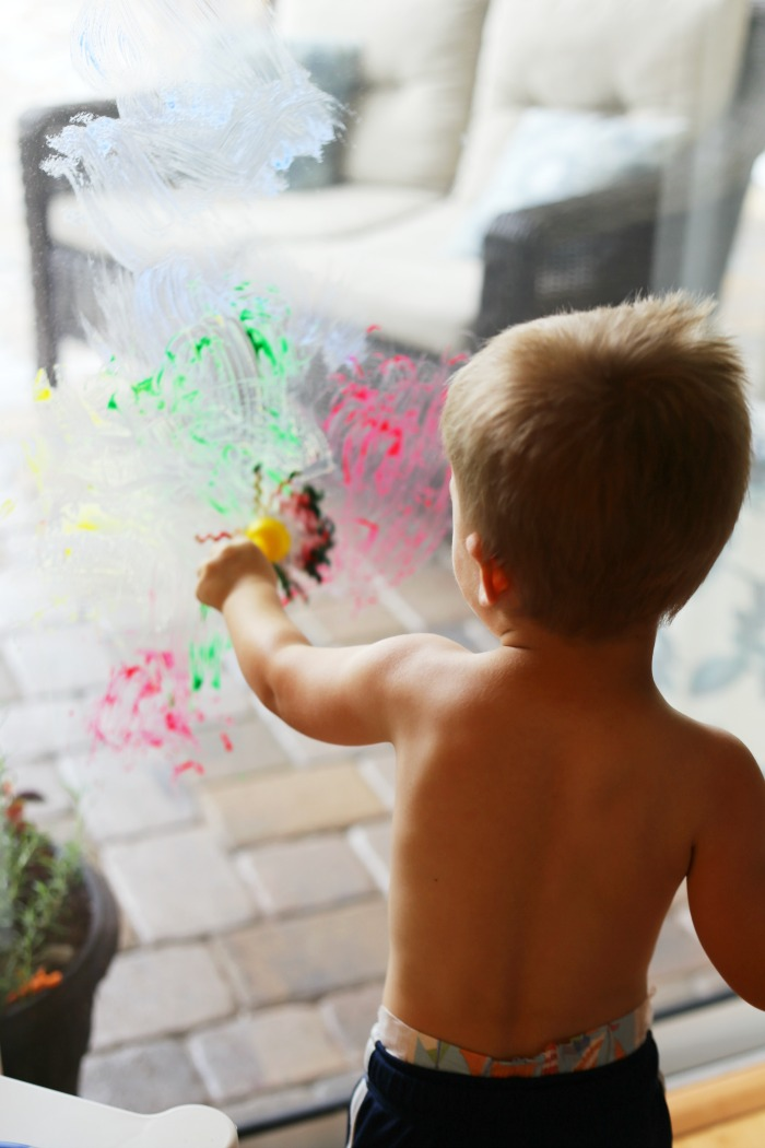 Window painting! A fun toddler art activity to try!