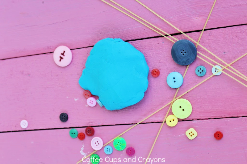 play dough, buttons and dry spaghetti for button activity for toddlers
