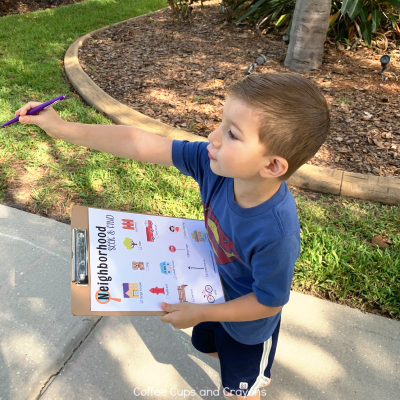 little boy with a clipboard pointing